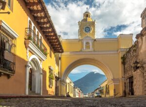 Yellow Arch in Antigua Guatemala with Agua Volcano in the Background